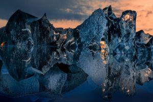 blue landscape cold reflection sculpture water iceberg sky clouds sunset nature
