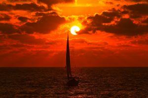 boat sun sea clouds