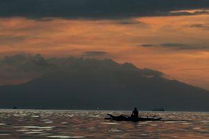 boat water sky landscape dark vehicle