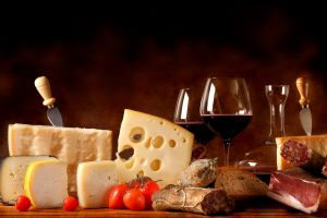 bread tomatoes meat food cheese wine