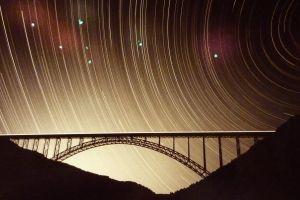 bridge silhouette star trails long exposure
