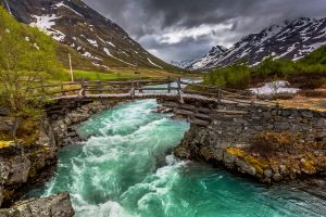 bridge water clouds river landscape trees mountains norway nature snow green