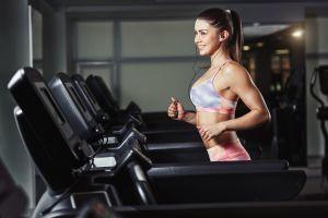 brunette gym clothes smiling sports bra gyms long hair model running treadmills women earphones exercising sports ponytail