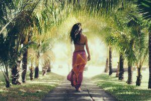 brunette long shirt palm trees dappled sunlight long hair back women on beach women