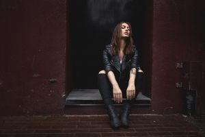 brunette women torn clothes sitting closed eyes leather jackets