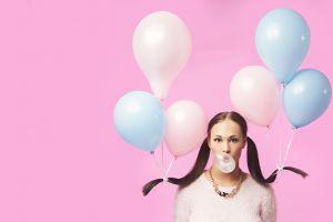 bubble gum balloon women model brunette pigtails white sweater