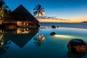 bungalow palm trees sea sunset stones horizon