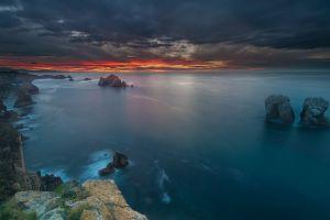 calm spain sea blue landscape clouds nature sunset sky coast rock