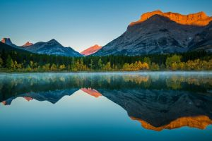 canada nature sunlight trees mist lake fall clear sky reflection forest landscape mountains