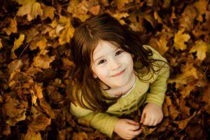 children smiling leaves