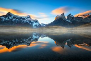 chile reflection torres del paine mist cyan lake mountains clouds snowy peak sunset landscape water sunlight nature
