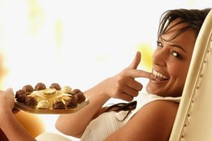 chocolate looking at viewer white clothing candy open mouth women smiling depth of field face portrait chair brunette finger in mouth hands model