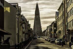city house street capital balcony cross building architecture car cityscape church iceland reykjavik clouds