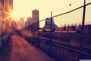 city rail yard sun rays railway