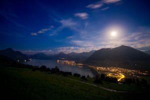 city stars lake lights grass clouds nature moon mountains sky switzerland landscape night