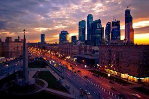 city street evening moscow cityscape monuments lights sunset cranes (machine) skyscraper clouds russia capital road town square