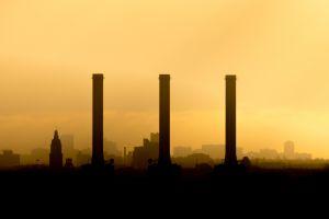 city sunlight cityscape chimneys