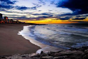 city sunset cityscape beach sea