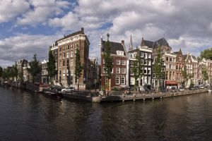 cityscape city building water clouds river amsterdam netherlands