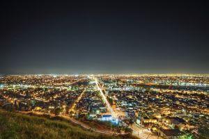 cityscape city lights horizon city light trails