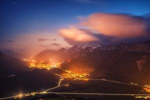 cityscape mist lights mountains landscape valley starry night nature road switzerland evening