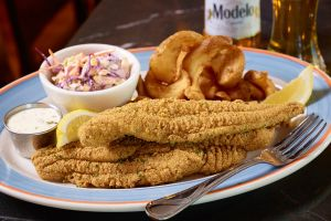 closeup food seafood fork chips beer fish lemons