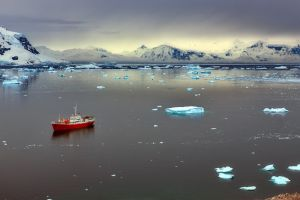 clouds antarctica sunlight iceberg mountains nature sea landscape ice snow ship reflection water