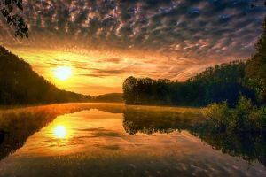 clouds calm landscape water liquid lake hills nature forest yellow mist yellow sunset