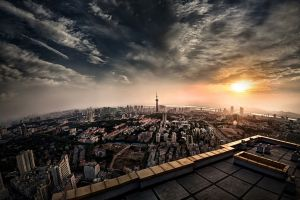 clouds city rooftops building sky cityscape sunset