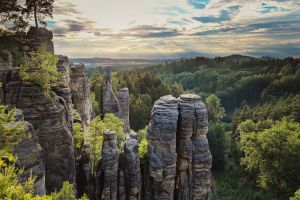 clouds hills forest sky trees czech republic landscape rock formation sunset nature