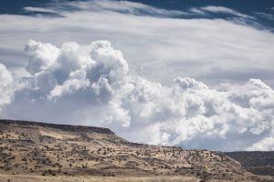 clouds landscape desert hill