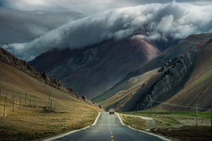 clouds road mountains
