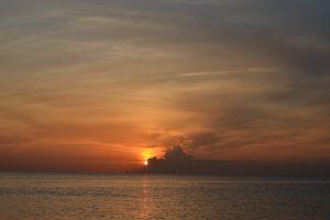 clouds sun horizon sea water sunset sky