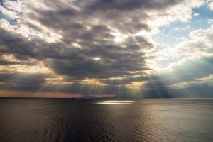 clouds sun rays sea horizon photography