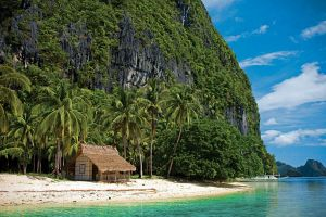 clouds tropical forest beach water landscape boat palm trees sky hut rock formation sea island nature summer tropical