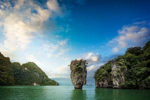 clouds tropical rock nature landscape bay trees limestone island sea thailand shrubs