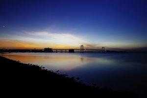 coast calm blue night bridge sunset calm waters