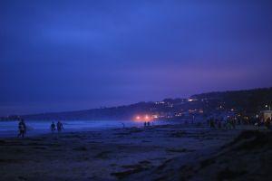 coast sea people dusk beach