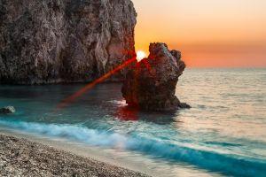 coast sun rays sea beach