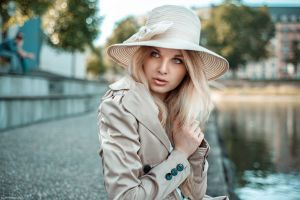 coats portrait trenches white coat face blonde women looking away trench coat millinery women outdoors blue eyes model