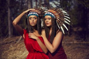 costumes tanned long hair two women looking into the distance indian women women headdress indian hat red dress