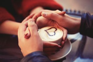 couple coffee holding hands