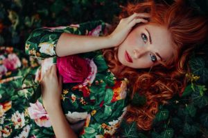 curly hair redhead leaves freckles looking at viewer nature long hair rose blue eyes women flowers model women outdoors