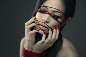 dark hair hand on face closed eyes juicy lips women