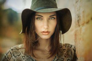 depth of field face hat brunette looking at viewer portrait millinery juicy lips women model green eyes