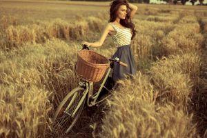 depth of field skirt field hands in hair brunette wavy hair looking away bicycle women outdoors long hair women