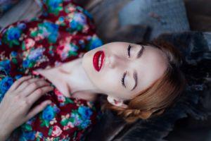 depth of field women auburn hair red lipstick lying down closed eyes