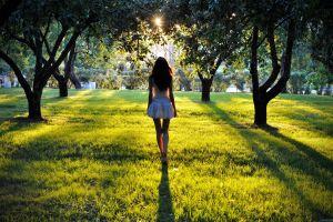 dress park legs nature looking away grass model women heels women outdoors sun trees back brunette