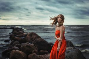 emotion brunette red dress women bare shoulders windy sea coast model evgeniy reshetov