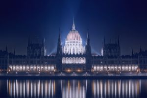 europe river lights architecture building night hungarian parliament building cityscape reflection water hungary old building city budapest
